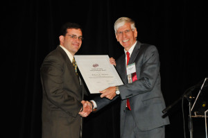 ECS President Paul Kohl presented one of the Society's esteemed awards at the 2014 ECS and SMEQ Joint International Meeting.