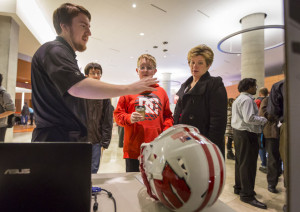 A UW senior medical engineer explains how the smart helmet can aid to player safety by using sensor technology.Credit: Andy Manis/Journal Sentinel