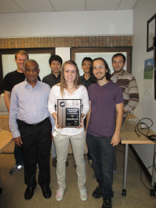 The 2014 Outstanding Student Chapter Award Plaque with Prof. Arumugam Manthiram (front left) with UT-Austin Student Chapter President (Josephine Cunningham, front middle) and Vice-President (Donald Robinson, front right) and student members Matthew West, Daeil Yoon, Ke-Yu Lai, and Benjamin Weaver (back left to right).