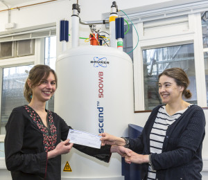 University of Cambridge Ph.D. candidate, Raphaële Clément (left), receives her ECS 2015 Summer Fellowship award check from advisor & ECS member, Professor Clare Grey (right).