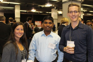 Attendees gathered together to network, discuss research, and collaborate with new associates.