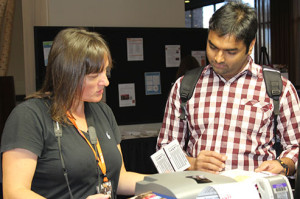 Dinia, who is ECS's graphic designer, helping register attendees at the 228th ECS Meeting