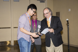 First place winner, Xiaoxing Xia accepting his certificate.
