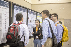Meeting attendees discussing the research presented at the Student Poster Session.