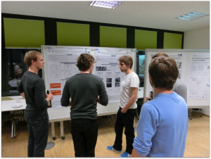 Discussion during poster session. From left to right: Maximilian Bernt, Lukas Seidl, Thomas Mittermeier, Ludwig Asen, Benedikt Brandes (hidden).