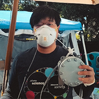 Stanford research scientist John Xu demonstrates modified N95 face mask.